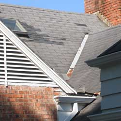 image of roof and shingle damage found in an inspection of a million dollar home